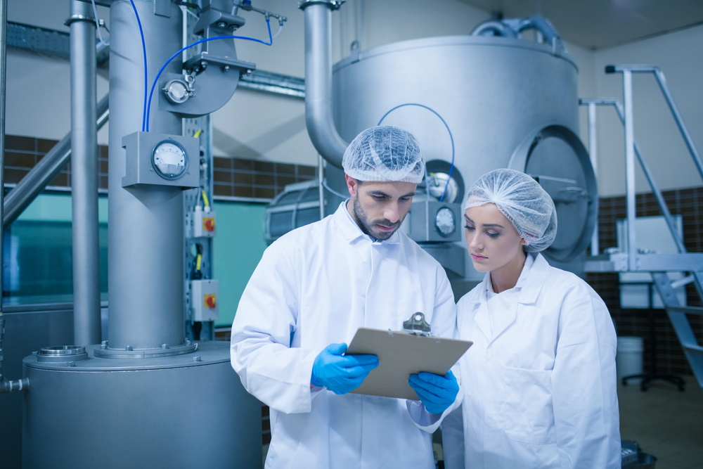Food technicians working together in a food processing plant-1