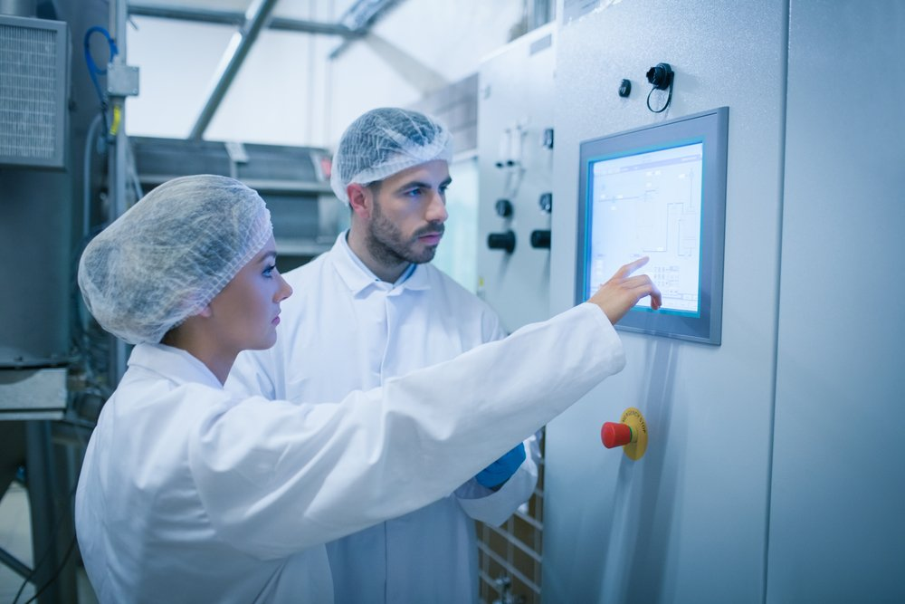 Food technicians working together in a food processing plant-3